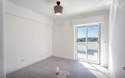 Living room, door to the terrace