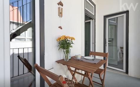 balcon avec accès à la buanderie et terrasse